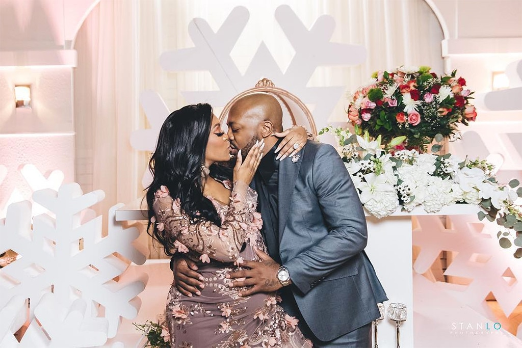 PDA Alert -  The  Real Housewives of Atlanta  star kisses her fiancé  Dennis McKinley .