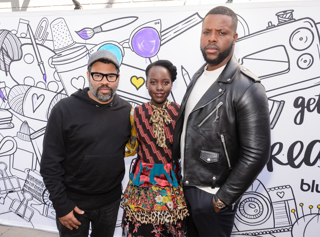 Jordan Peele, Lupita Nyong'o & Winston Duke -  Jordan Peele, who wrote and directed the horror movie  Us , smiles alongside two of the film's co-stars.