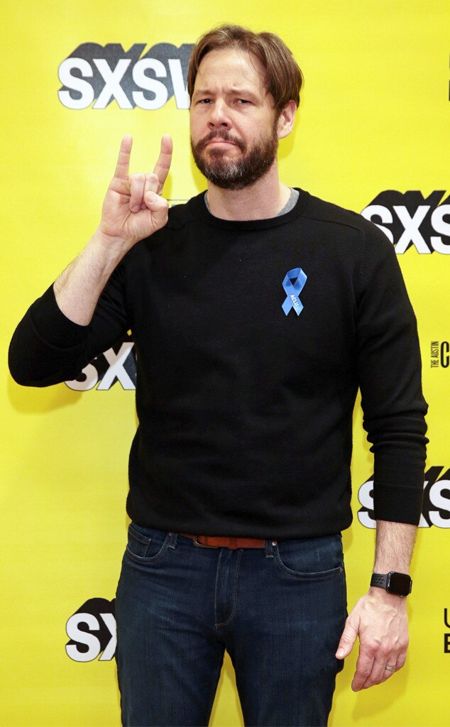 Ike Barinholtz - The Mindy Project  actor makes a Hook 'Em hand gesture. He joined Heard, Padma Lakshmi and ACLU's executive director Anthony Romero.