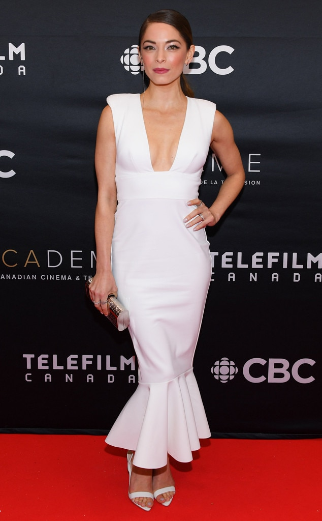 Clean Slate -  Actress  Kristin Kreuk  is looking classy in a white mermaid dress paired with sandal heels and bronze clutch at the 2019 Canadian Screen Awards Broadcast Gala in Toronto.