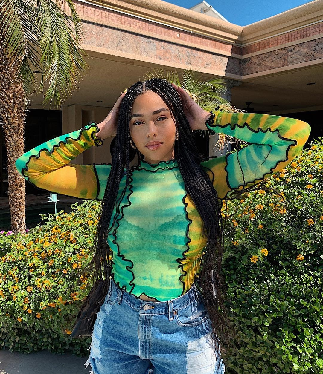 Jordyn Woods -  The social media personality, who made a surprise appearance during  Jaden Smith 's performance, goes for a lime green look.