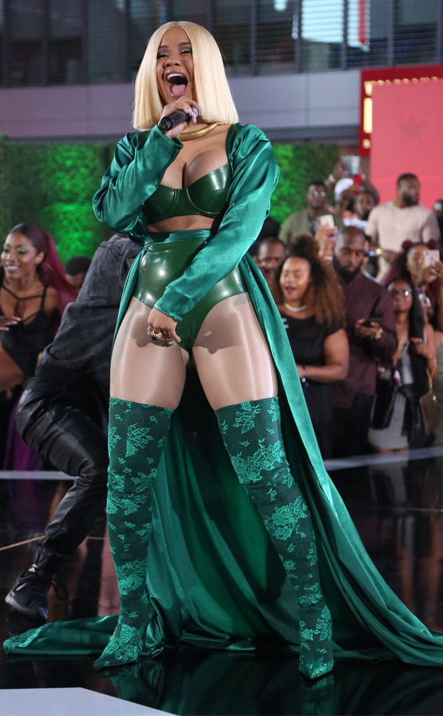 "Money Bag -  The Bronx-born rapper makes everyone green with envy in her custom emerald two-piece by Vex Clothing, Dare to Be Vintage robe and Balenciaga boots. If anything, she most certainly is  giving us ""trap Selena"" vibes ."
