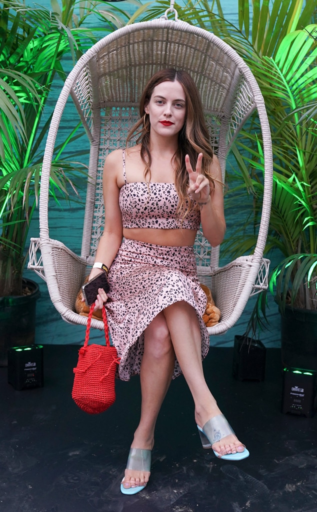Riley Keough -  It wouldn't be Coachella without a cute floral dress and a casual peace sign.