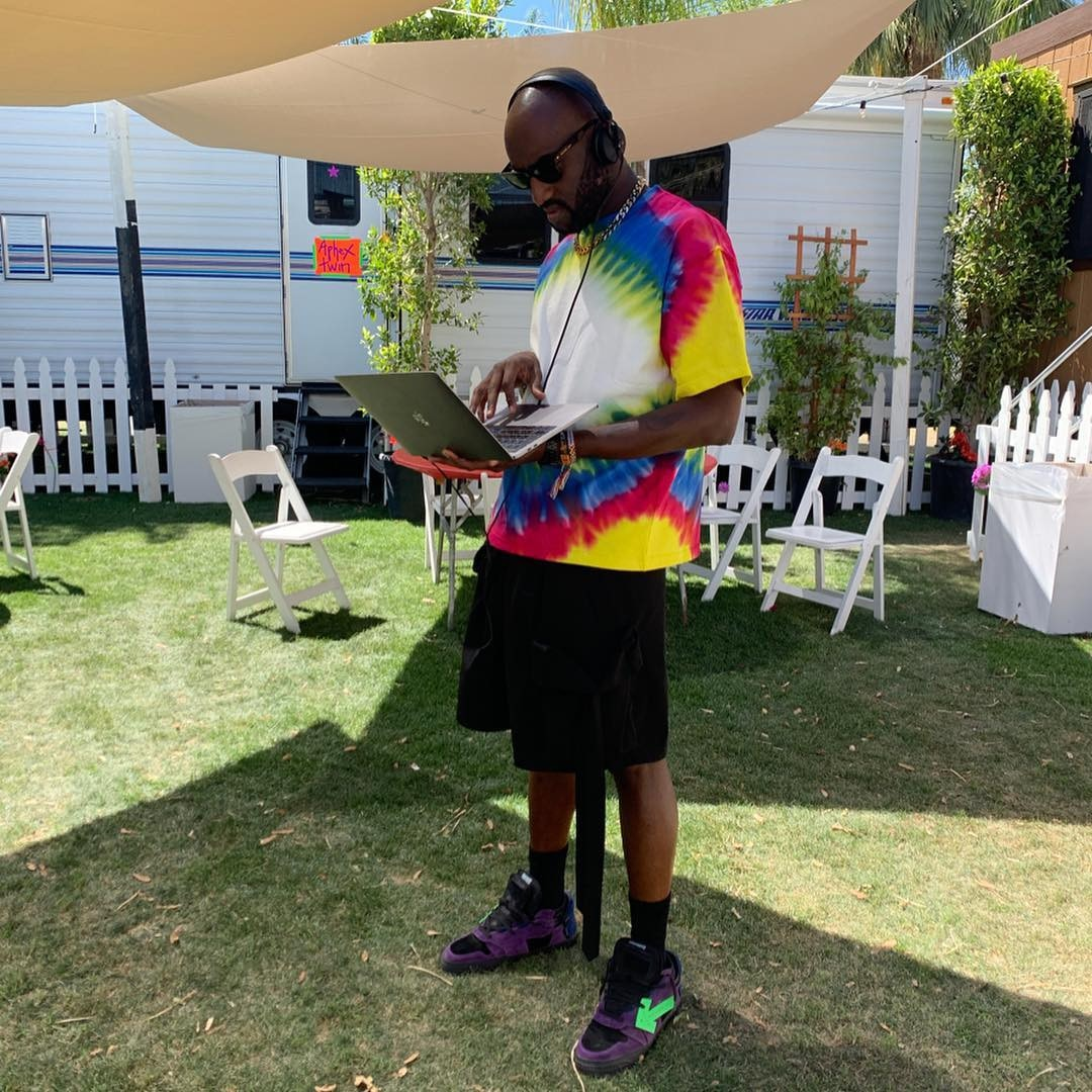 Virgil Abloh -  The D.J. and fashion designer preps for his set on Day 2.