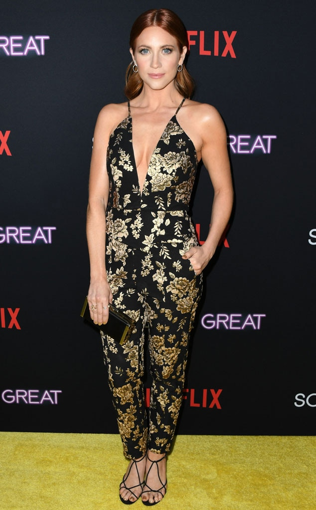 Dark Bloom -  Actress  Brittany Snow  rocks a black and gold floral jumpsuit with strap heels at the premiere of  Someone Great  in Los Angeles.