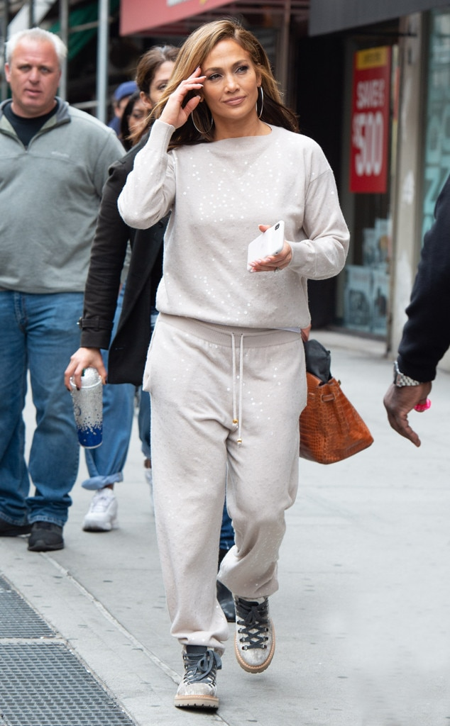Jennifer Lopez -  Bling bling! Jenny from the Block is back in character on set of her new movie  Hustlers  in NYC, rocking a bedazzled sweatsuit and glittery Timberlands.