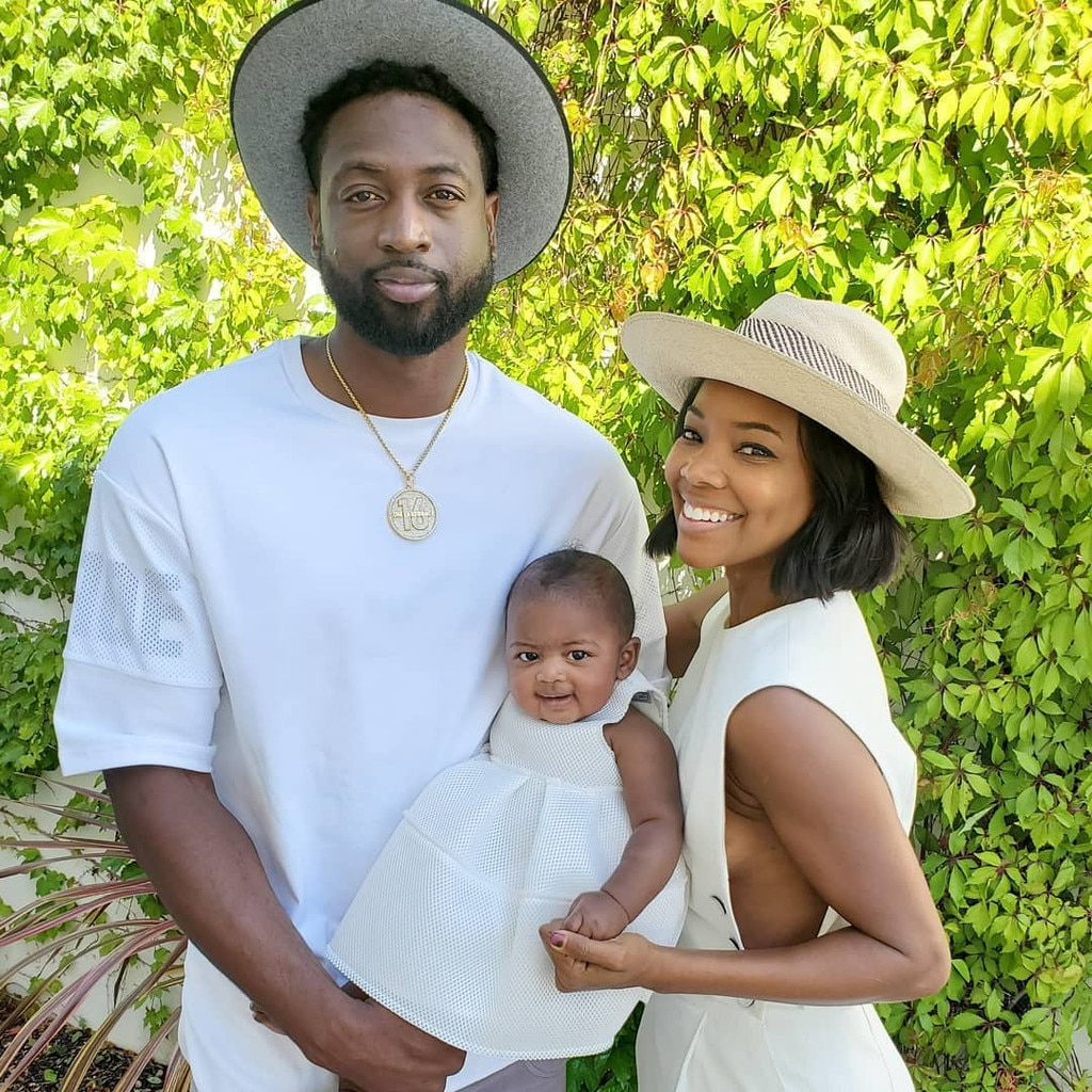 Dwyane Wade, Gabrielle Union & Kaavia James -  Kaavia James smiles in her white dress as her parents pose for a sweet family photo on Easter.