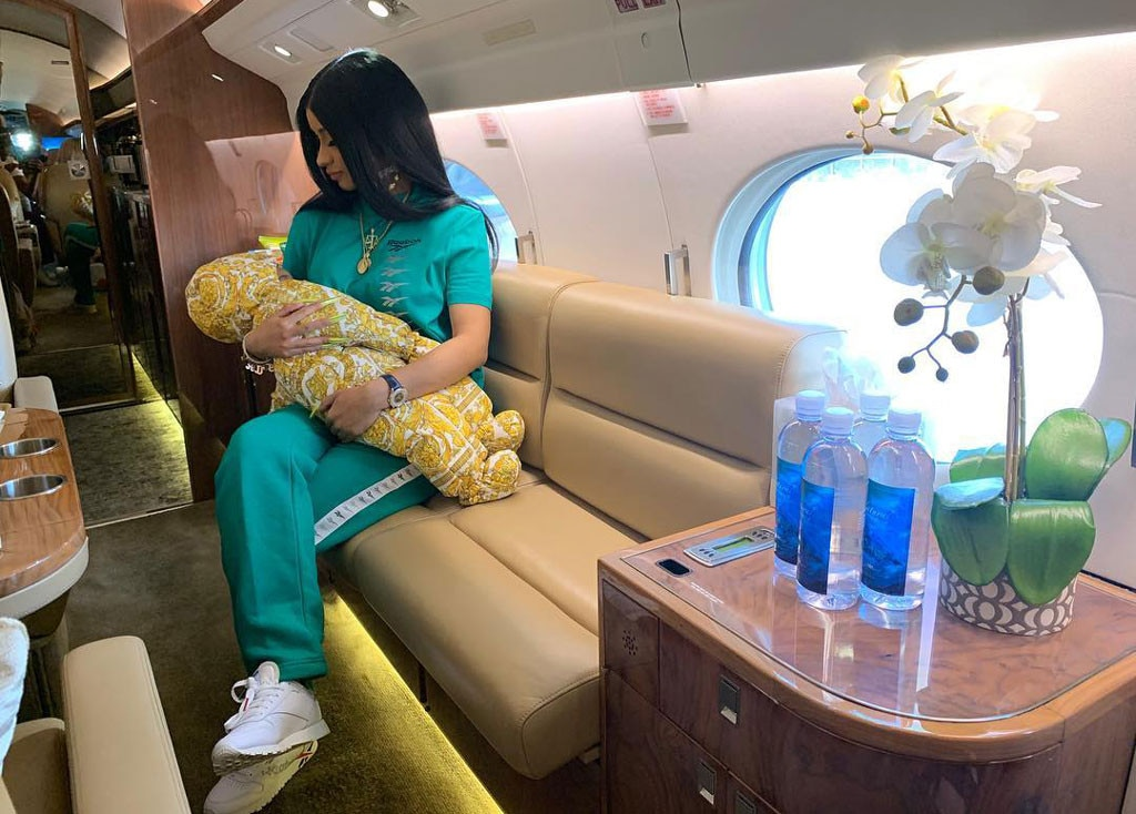 "Private Jet -  Cardi shared a photo of herself holding Kulture on a plane in January. ""I gotta fly I need a jet yea I need room for my legs , I got a baby I need some money shiieeet I need cheese for my egg ❤️ #Reebok,"" Cardi captioned the  Instagram  post."