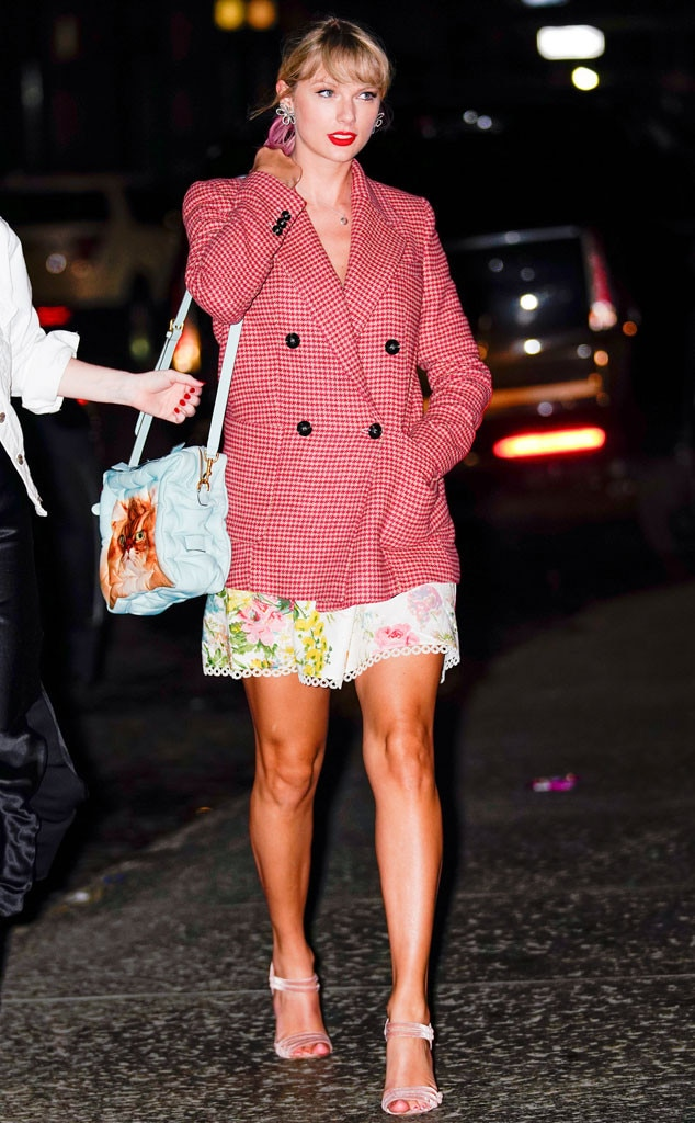 Taylor Swift -  The superstar singer arrives in style to the party, wearing a floral dress by Zimmermann, a Mango houndstooth coat and anAnya Hindmarch purse (with a cat on it, of course!).