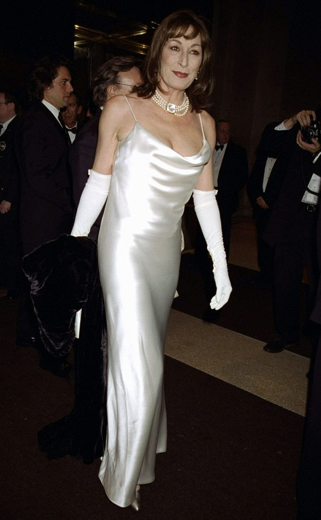 Anjelica Huston -  The Addams Family  starwows in a slinky silk dress.