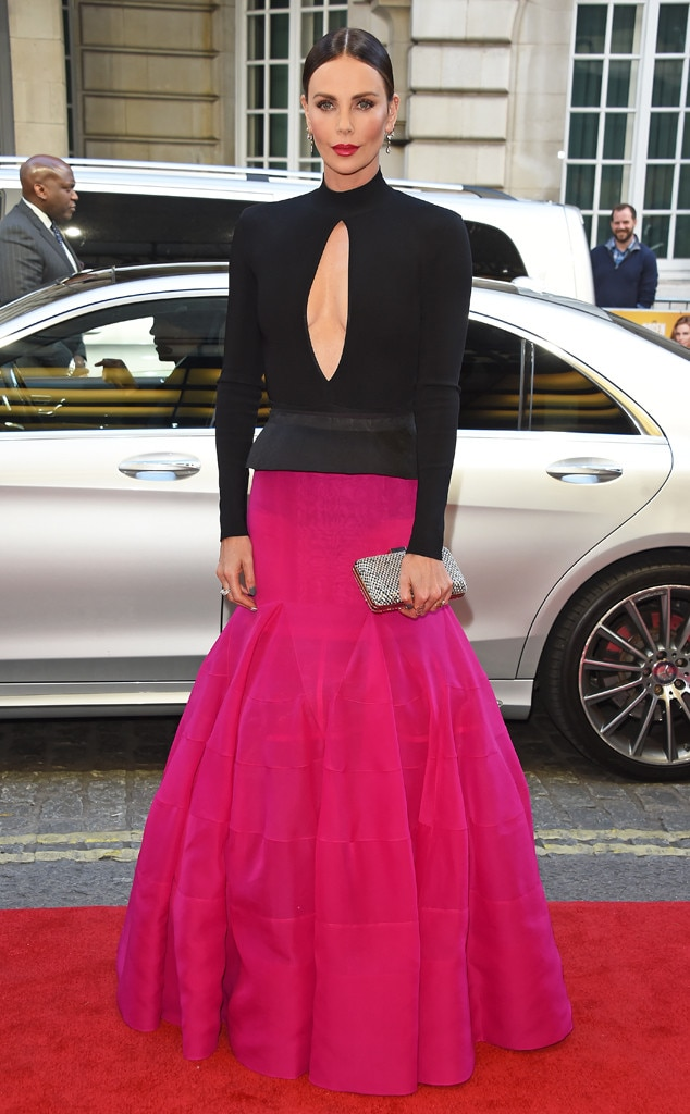 Pink Perfection -  Actress  Charlize Theron  looks incrediblein a two-piece black and pink Givenchy dress to the Long Shot  premiere in London.