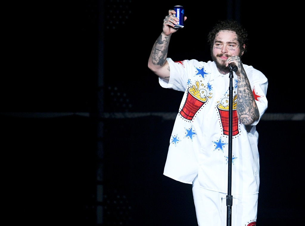Cheers to that -  Posty gets into Game Day mode at theBud Light Super Bowl Music Fest on Feb. 1. The singer tends to have a beer in his hand onstage, and he went the extra step during this concert to rep his love of Bud Light on his shirt.