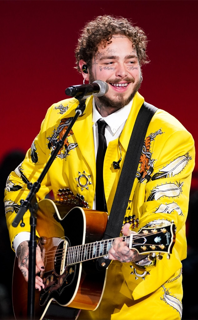 An Ode to the King -  Posty strums his guitar at an Elvis All-Star tribute. This yellow suit holds a special place in both Malone and Hahn's hearts.