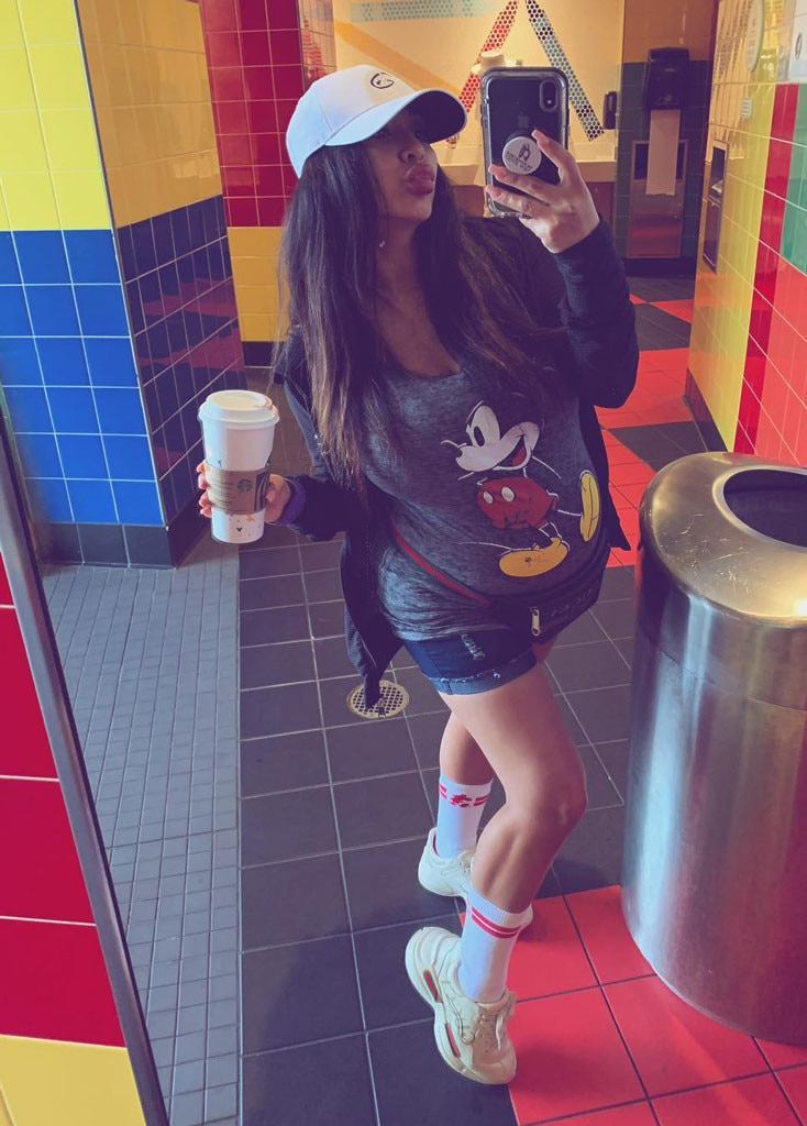 Strike a Pose -  Snooki does a day at Disney in style with a Mickey Mouse shirt and plenty of coffee.