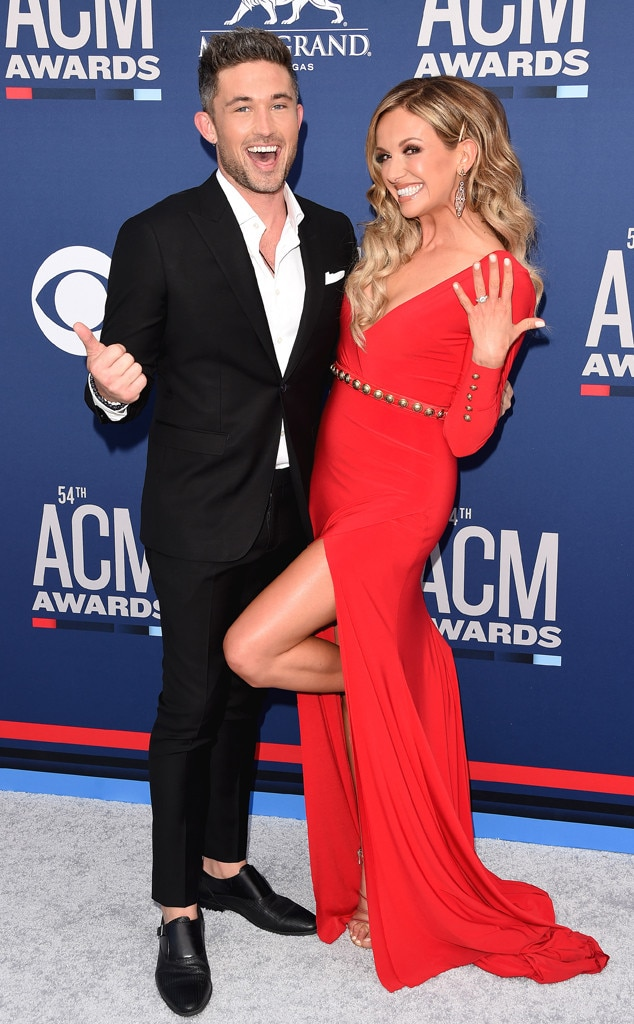 Michael Ray & Carly Pearce -  Can you feel the love? The newly engaged couple has a whole lot of fun posing for photographers in their fashionable outfits.