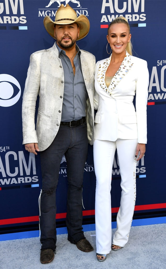 Jason Aldean & Brittany Aldean -  Before accepting the ACM Dick Clark Artist of the Decade award, the country singer and his wife pose for happy photographers.