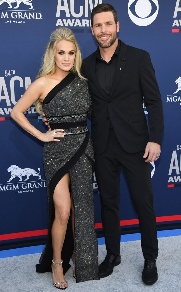 Carrie Underwood & Mike Fisher -  She's here! The  American Idol  winner and her husband are #CoupleGoals while walking the red carpet outside the MGM Grand Garden Arena.