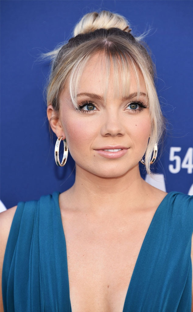 "Danielle Bradbery's Hair -  Hairstylist  Tarryn Feldman  says she pulled inspiration from Hailey Baldwin ""with a ballerina top knot and wispy bang moment."" She used ""Kevin Murphy everything and a Kristin Ess hair accessory"" to create the special red carpet look."