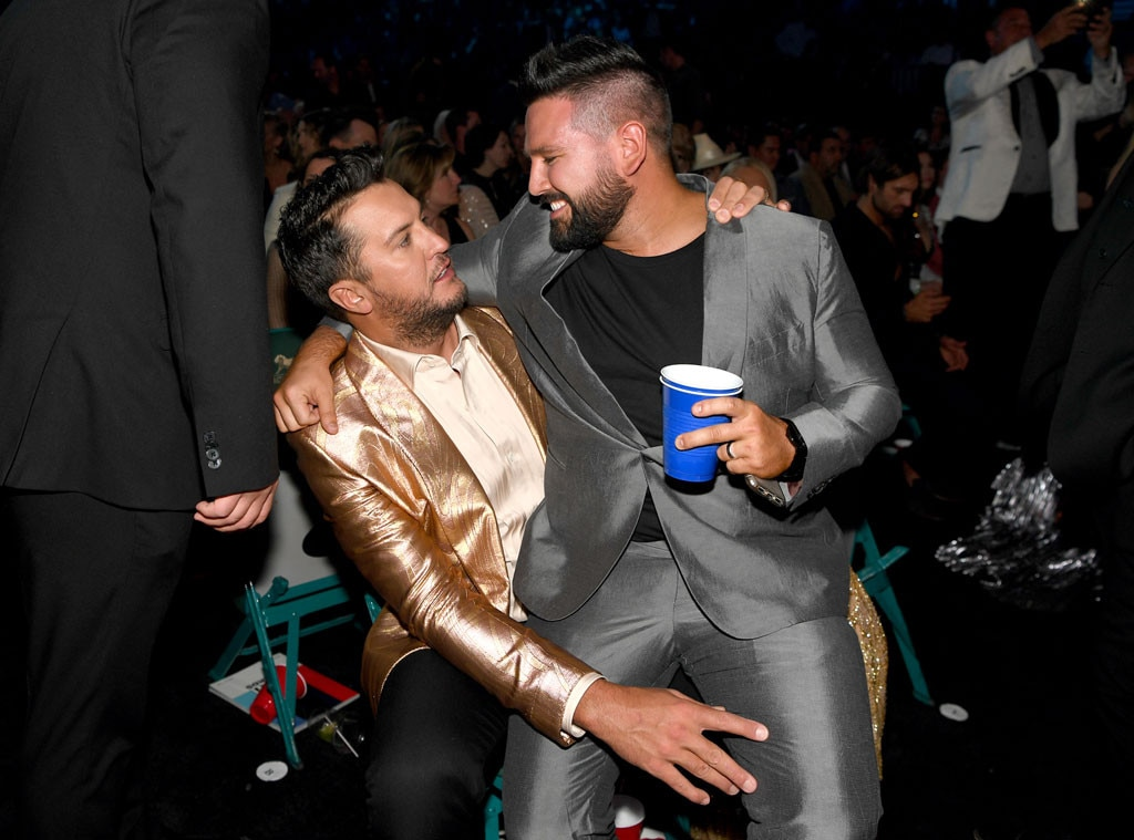 Luke Bryan & Shay Mooney -  It looks like the  Dan + Shay  star found a comfortable seat.