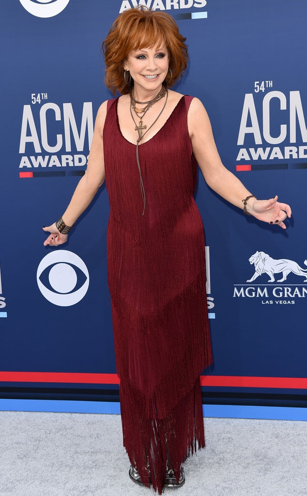 Reba McEntire -  The 2019 ACM Awards host made us do a double take in a red, fringe gown and black cowboy boots.