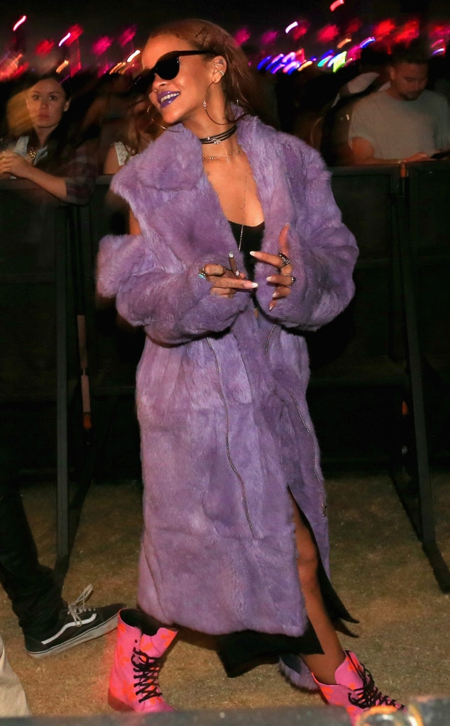 Rihanna (again) -  Rihanna has fashion on the brain as she smiles in style in her purple fur coat and neon pink Dr. Martens combat boots.