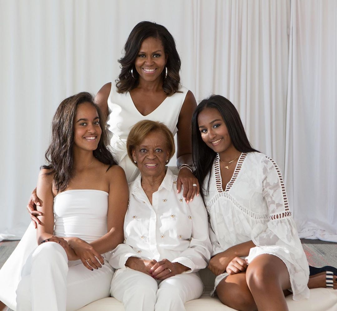 Michelle Obama -  The former First Lady shared this photo of her and former President  Barack Obama 's daughter  Malia  and  Sasha , and her own mother,  Marian Shields Robinson .