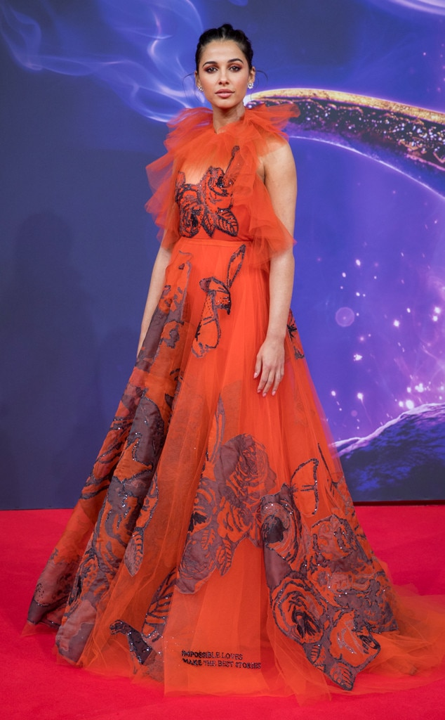 Tulle & Roses -  Actress  Naomi Scott  stuns in a red tulle gown with a rose print at the Aladdin Gala Screening in Berlin, Germany.