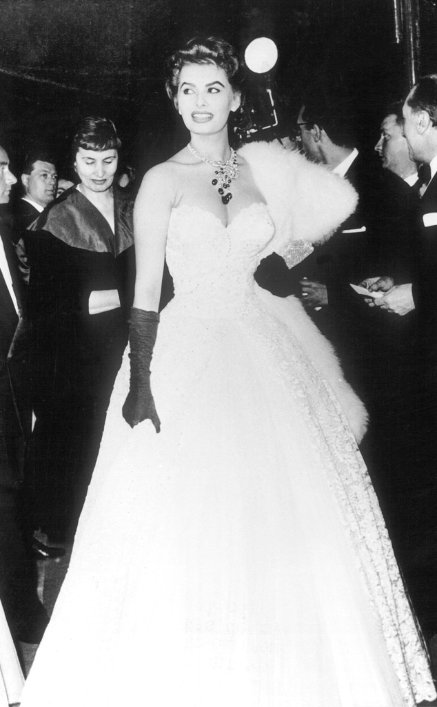 Sophia Loren -  The legendary screen siren is the definition of glamour with this lavish ball gown. From the black long gloves to her opulent shawl, this look is iconic for a reason.
