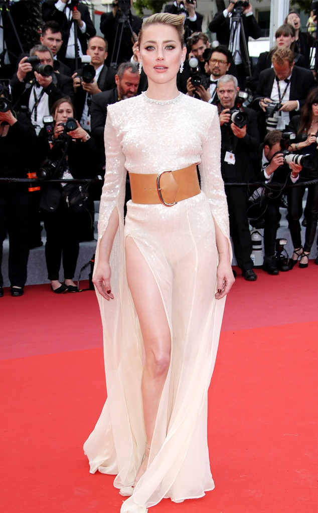Belt Up -  Actress  Amber Heard  steals the spotlight at the  Les Miserables  premiere in Cannes, wearing a embellished gown and a wide tan belt.