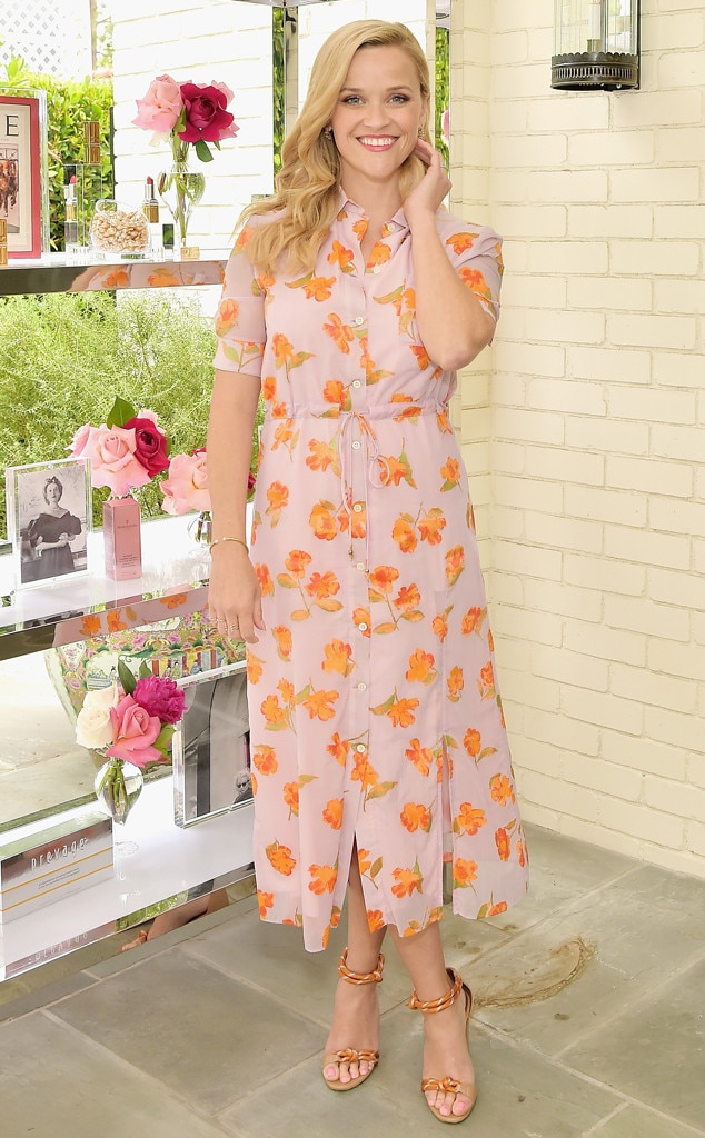 Reese Witherspoon -  Radiant Reese! The actress is ready for spring in a floral dress and orange sandal heels at the Elizabeth Arden Garden Party in Beverly Hills.
