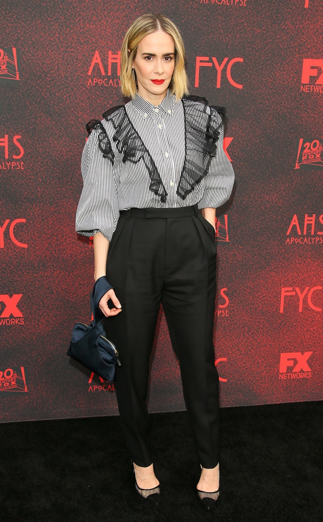 To Die For -  Actress  Sarah Paulson  goes appropriately goth chic at the FYC event for  American Horror Story: Apocalypse , wearing a striped shirt with sheer black ruffles, black mesh heels, and a blood red lip.