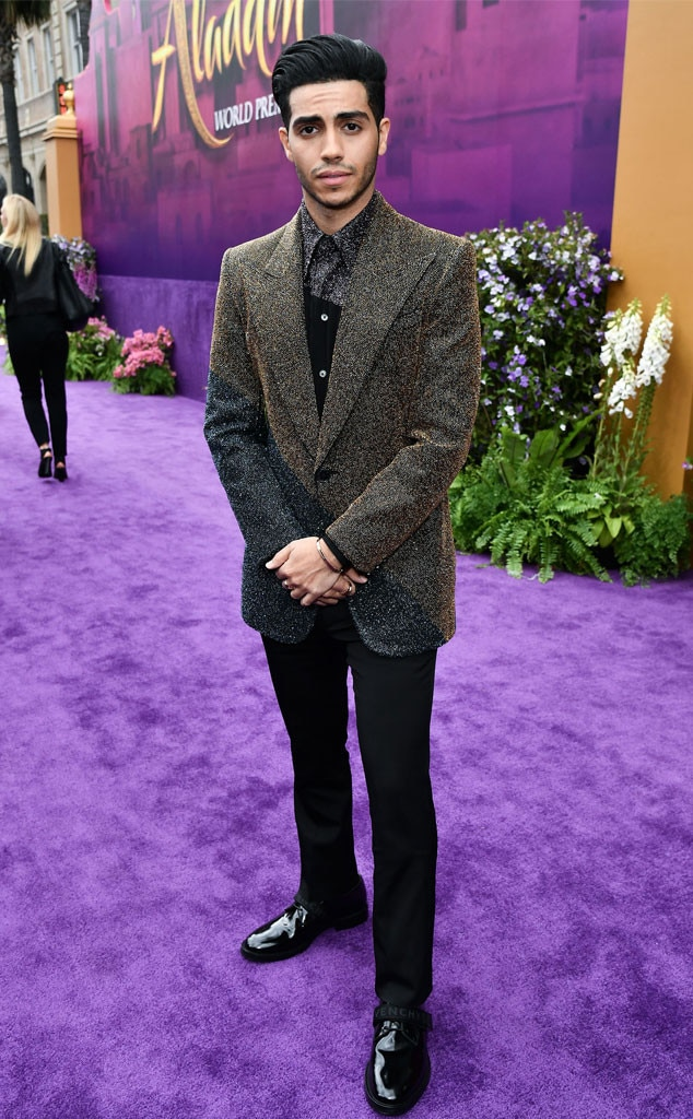 """Mena Massoud -  The 27-year-old actor looks like """"Prince Ali"""" in the flesh! Wearing a flashy multi-colored Givenchy suit, Massoud lights up the """"purple magic carpet"""" (as Disney cleverly dubbed it)."""