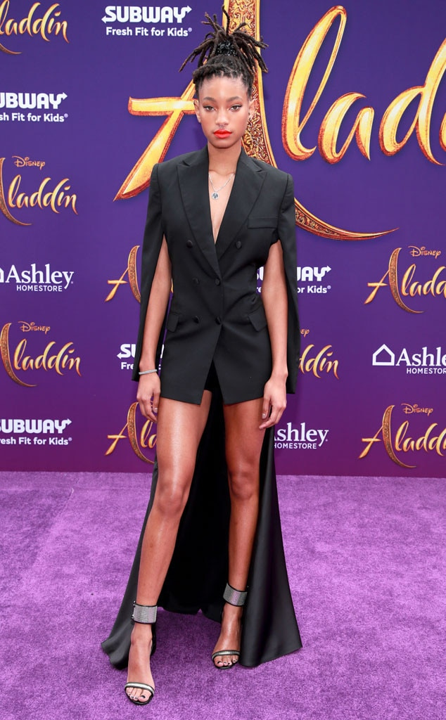 Willow Smith -  The 18-year-old singer-songwriter goes glam for the special occasion in a tuxedo-like romper. Her brightred-orange lip and diamond-studded heelsare a chef's kiss!