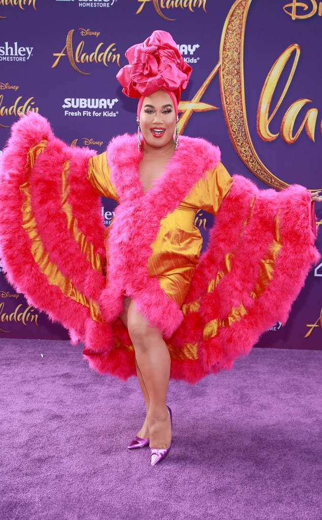 Patrick Starr -  Never one to dress basique, the YouTube sensation goes bold for the special occasion in a hot pinkand marigold dress, complete with feather trim, purple pumps and a Barbie pink turban.