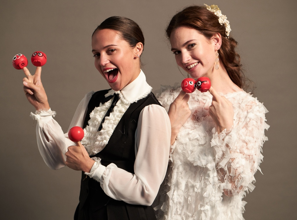 Alicia Vikander & Lily James -  Two thumbs-up!