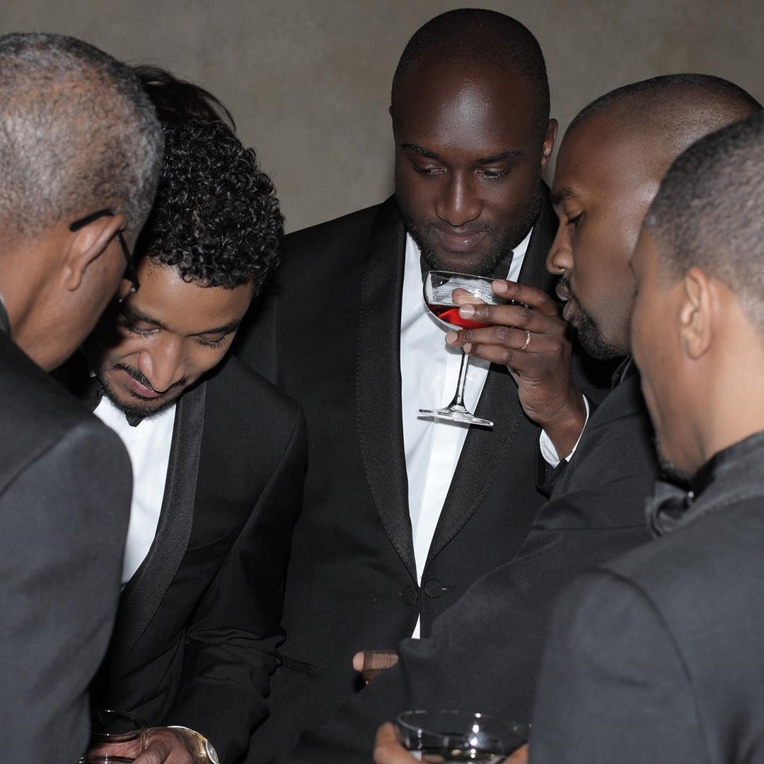 "Time to Celebrate -  Kanye's pals, including Virgil Abloh, can be seen surrounding the ""Stronger"" superstar with drinks in hand."