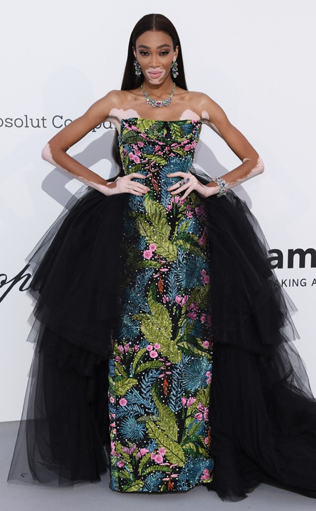Winnie Harlow -  The  America's Next Top Model  alumna shines in a floral column dress with a sleek black train.