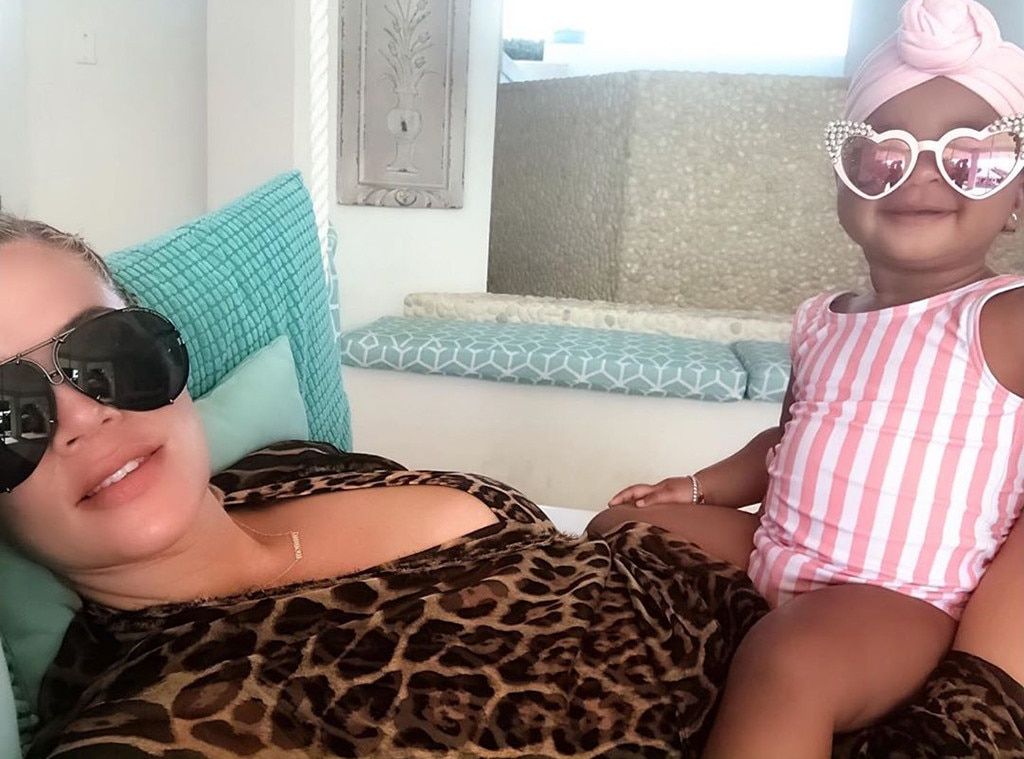Vacation Vibe -  Stripes and spots and smiles, oh my! Khloe and True look happy as can be cuddling up for a selfie during their Turks and Caicos trip.
