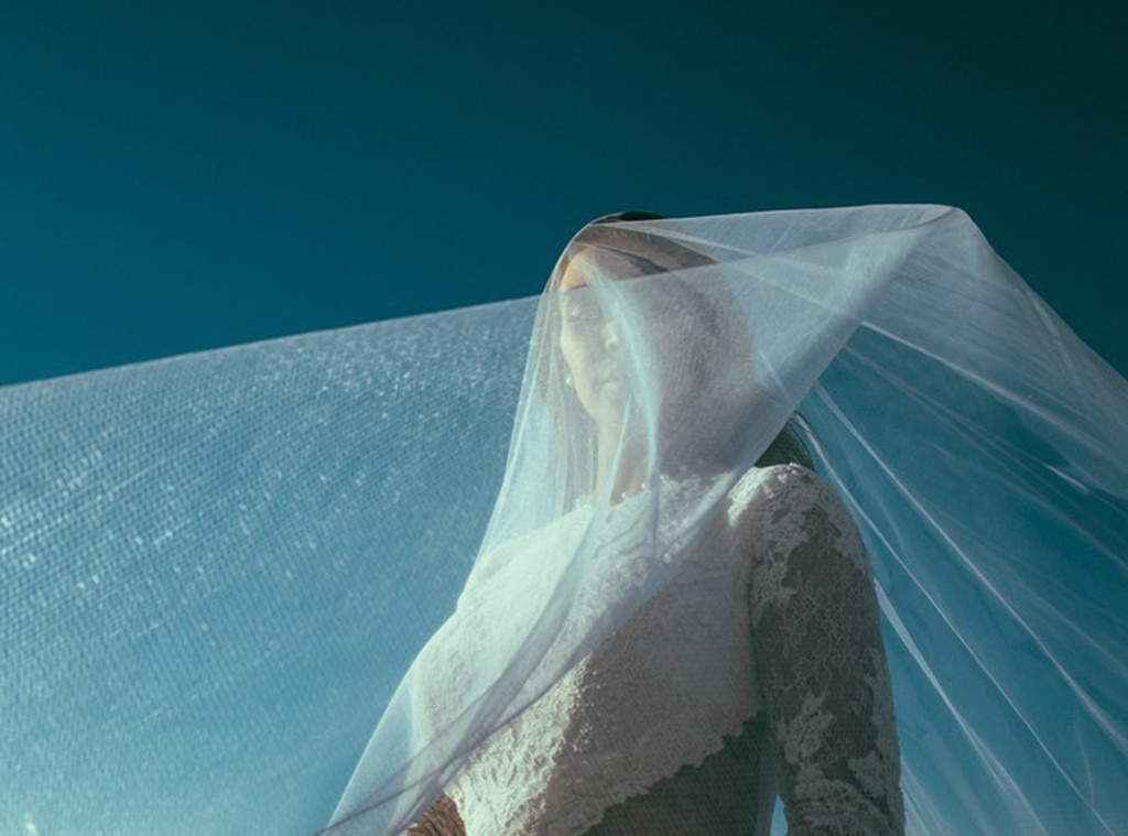 Blushing Bride -  Kim stuns in this lovely shot of her wedding veil in full swing.