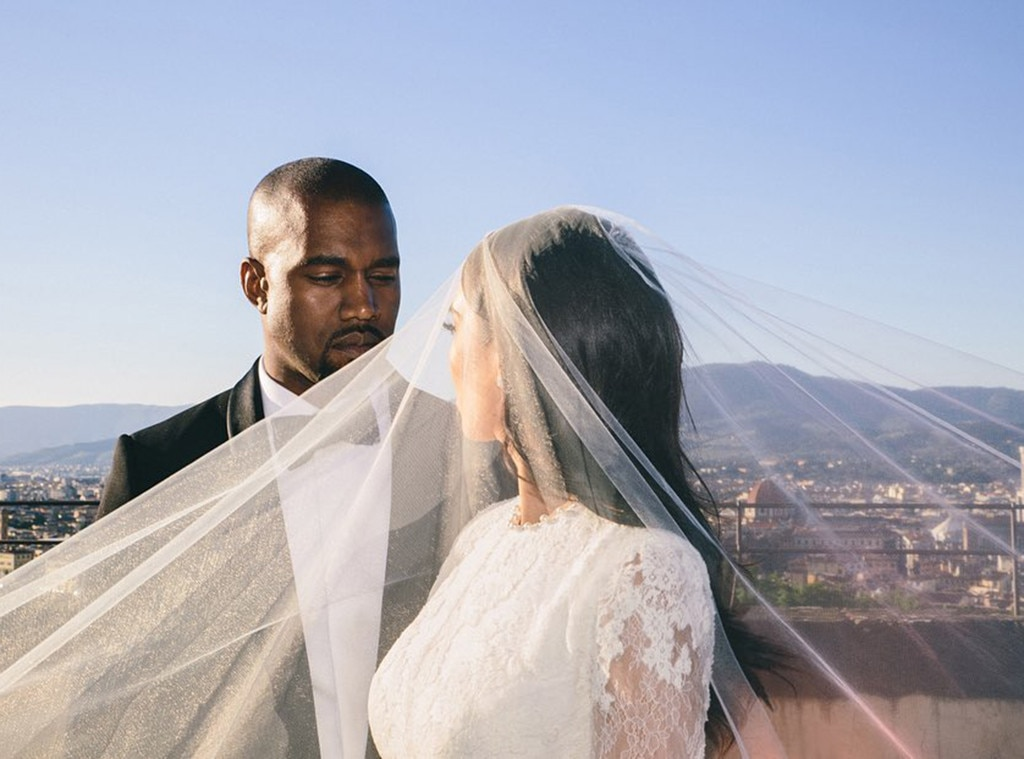 Dreamy -  Kim does an elegant twirl for the camera while Kanye looks on with adoration.