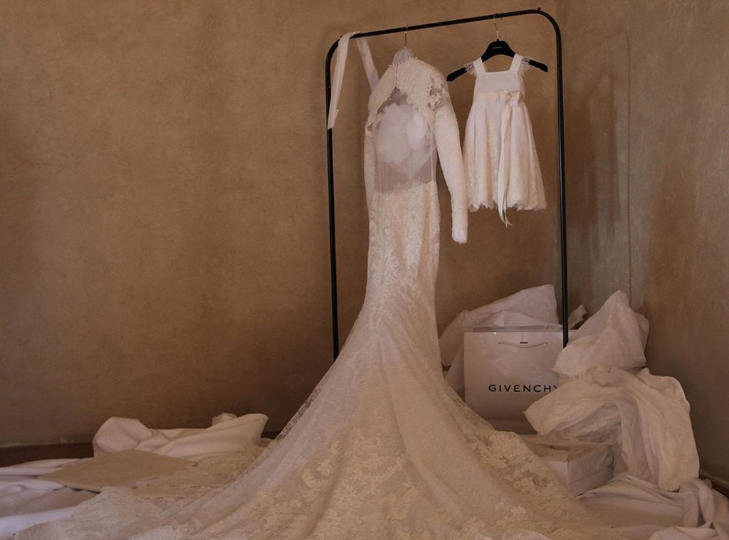 Mom & Me -  Kim's Givenchy wedding gown hangs beside a matching version for daughter  North West .