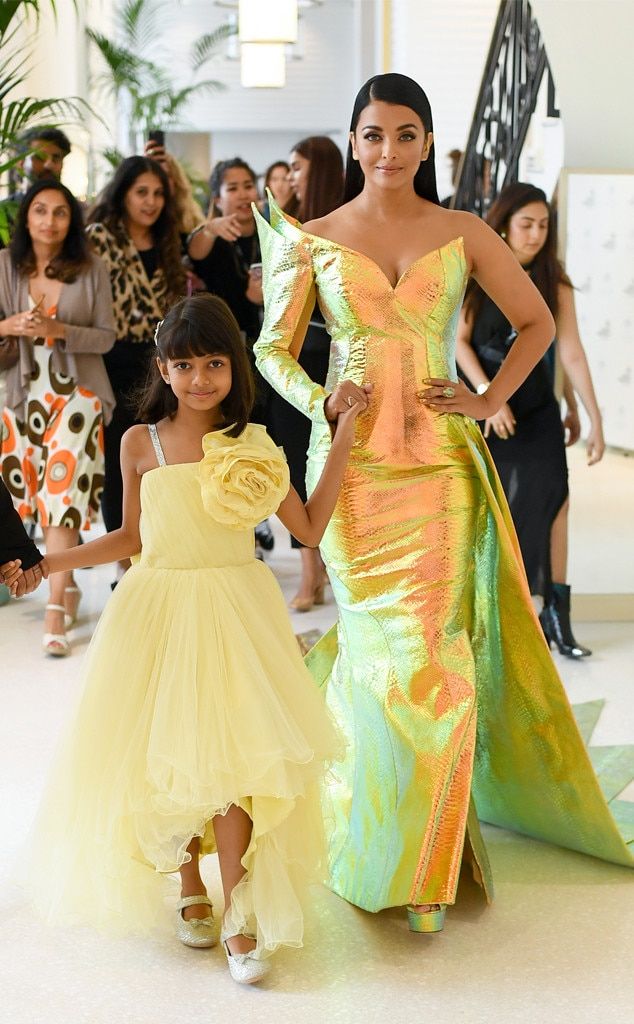 Aishwarya Rai & Aaradhya -  The 45-year-old actress stuns in a holographic green and yellow gown while her little mini me stuns in a bright yellow dress. Cuties!