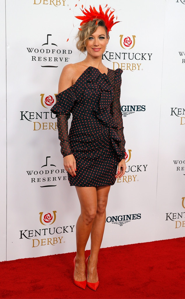 Natalie Zea -  The  Justified  star pairs her little black polka dot dress with a red hat.