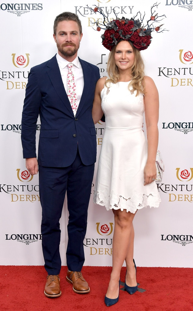 Stephen Amell & Cassandra Jean Amell -  The  Arrow  star's shirt and tie match his wife's rosy headpiece and dress at the Kentucky Derby.
