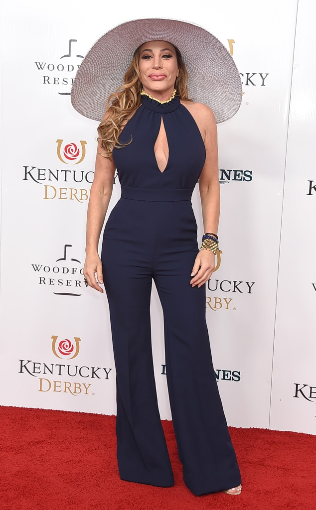 Taylor Dayne -  The singer looks glamorous in a navy blue jumpsuit and wide-brimmed hat.