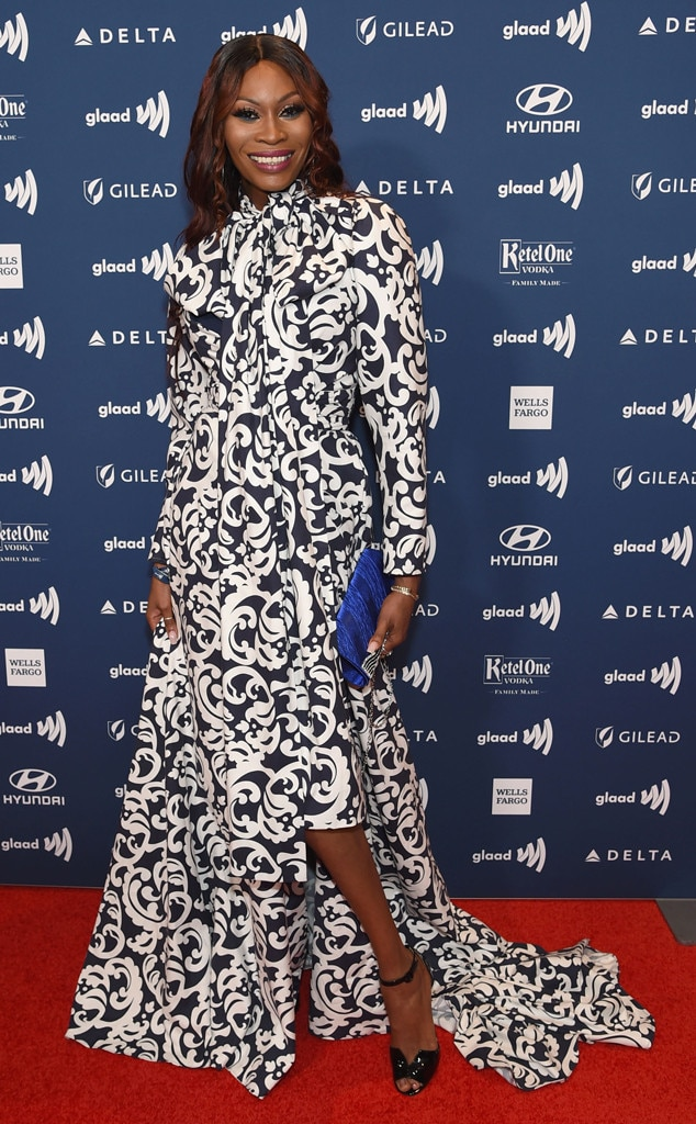 Dominique Jackson -  The Pose  star smiles in a gorgeouspatternedblue and white dress on the red carpet.