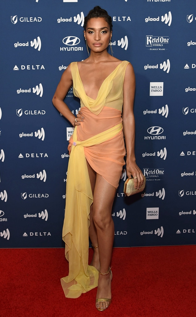 Indya Moore -  Indya Moore shows off their toned legs in a short peach and yellow dress on the red carpet in New York.