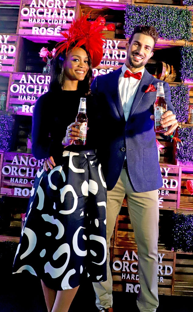 Rachel Lindsay & Bryan Abasolo - The Bachelorette  star and her fiancé hold up bottles of Angry Orchard rosé cider at the 2019 Kentucky Derby. The couple matched colors with that same red as a Bachelor Nation rose.