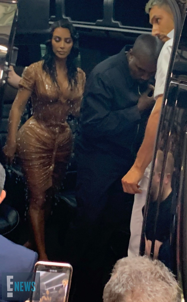 """Kim Kardashian & Kanye West -  The E! star is spotted in a nude Mugler dress on her way to the Met Gala with the """"Stronger"""" rapper."""