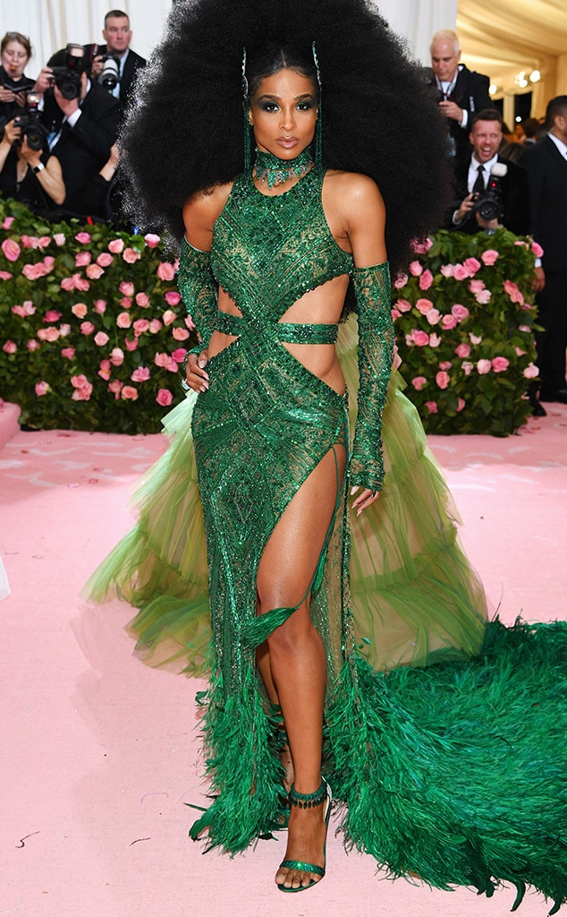 """Ciara -  The """"Level Up"""" singer wore a bold custom emerald gown by Dundas with feathered hem, gloves, belt and matching choker. Her House of Malakai crystal headpiece and Gianvitto Rossi sandals added to the great look."""